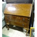 """A 20thC mahogany bureau on ball and claw feet. Approx. 40"""" high Please Note - we do not make"""