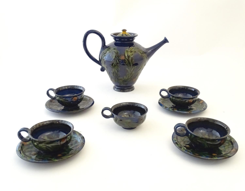 A quantity of Kahler Keramik Danish studio pottery tea wares, comprising a teapot and four cups