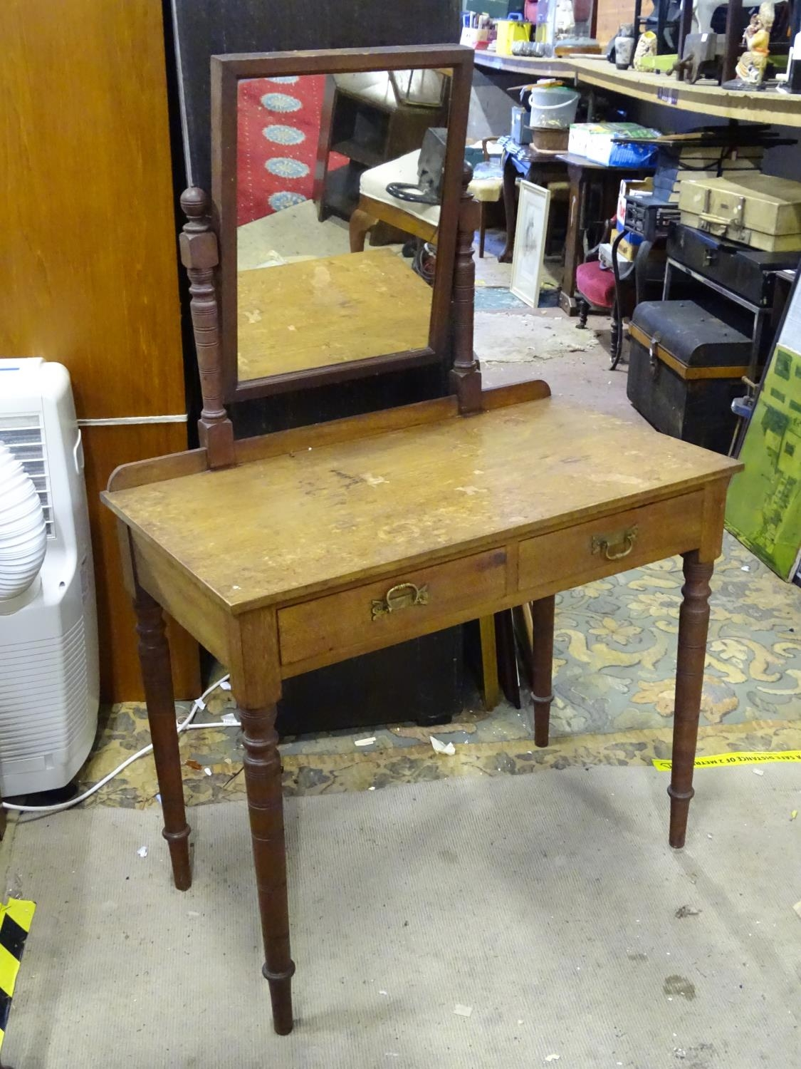 """A late 19th / early 20thC mahogany dressing table with two drawers and a mirror. Approx. 56"""" tall."""