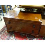 A 19thC and later mahogany low cabinet with two drawers Please Note - we do not make reference to