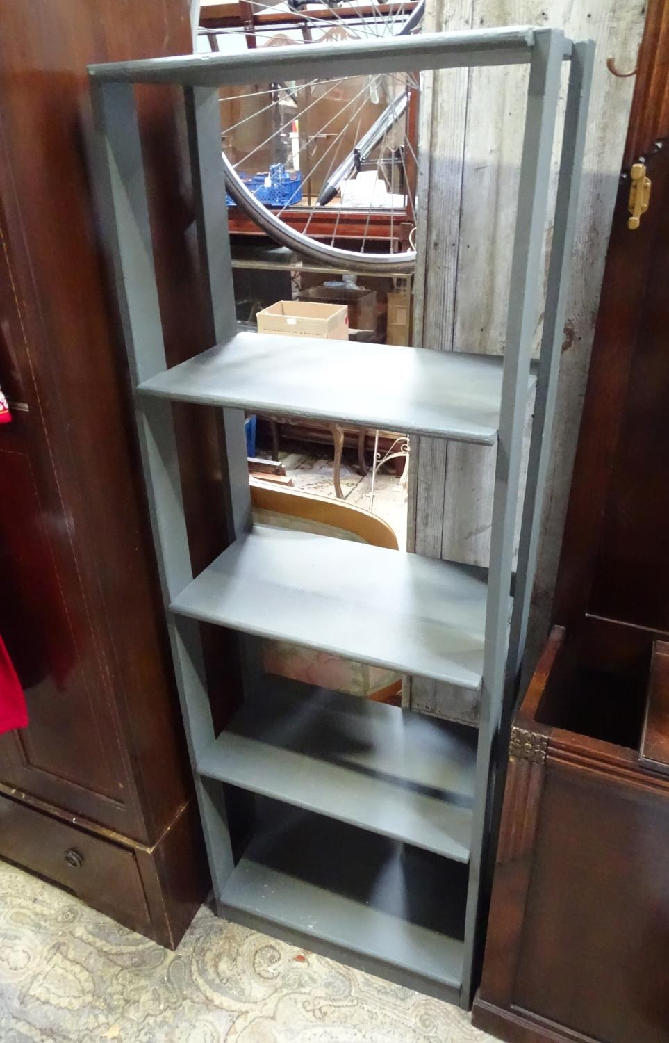 A grey painted bookshelf Please Note - we do not make reference to the condition of lots within