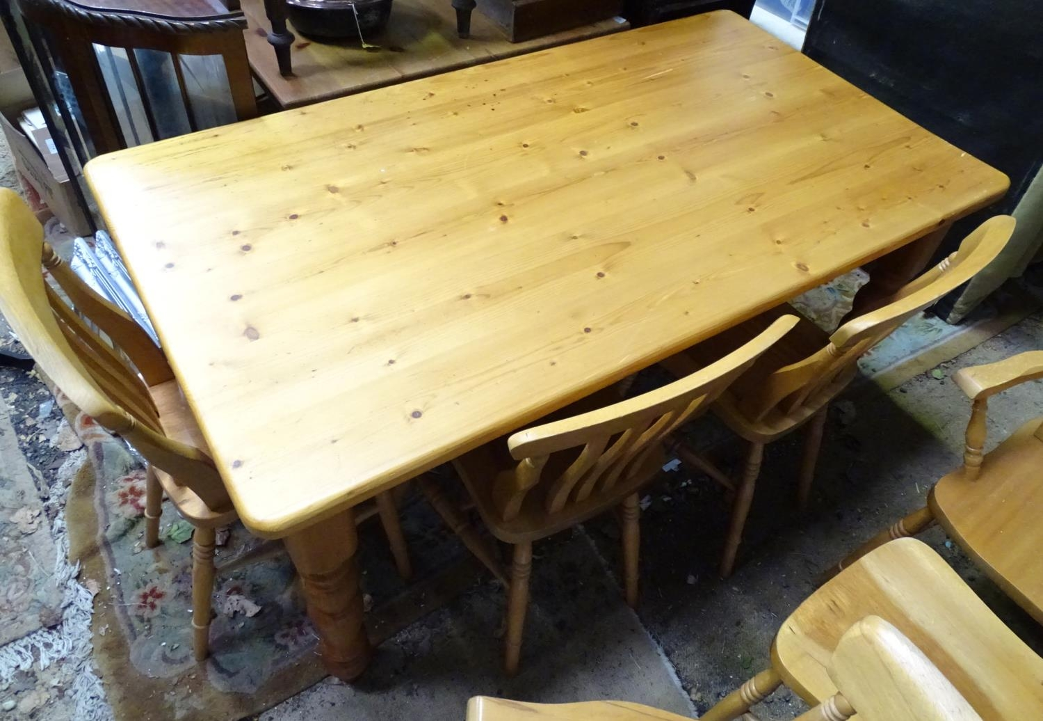 A pine dining table with 6 chairs Please Note - we do not make reference to the condition of lots - Image 4 of 5