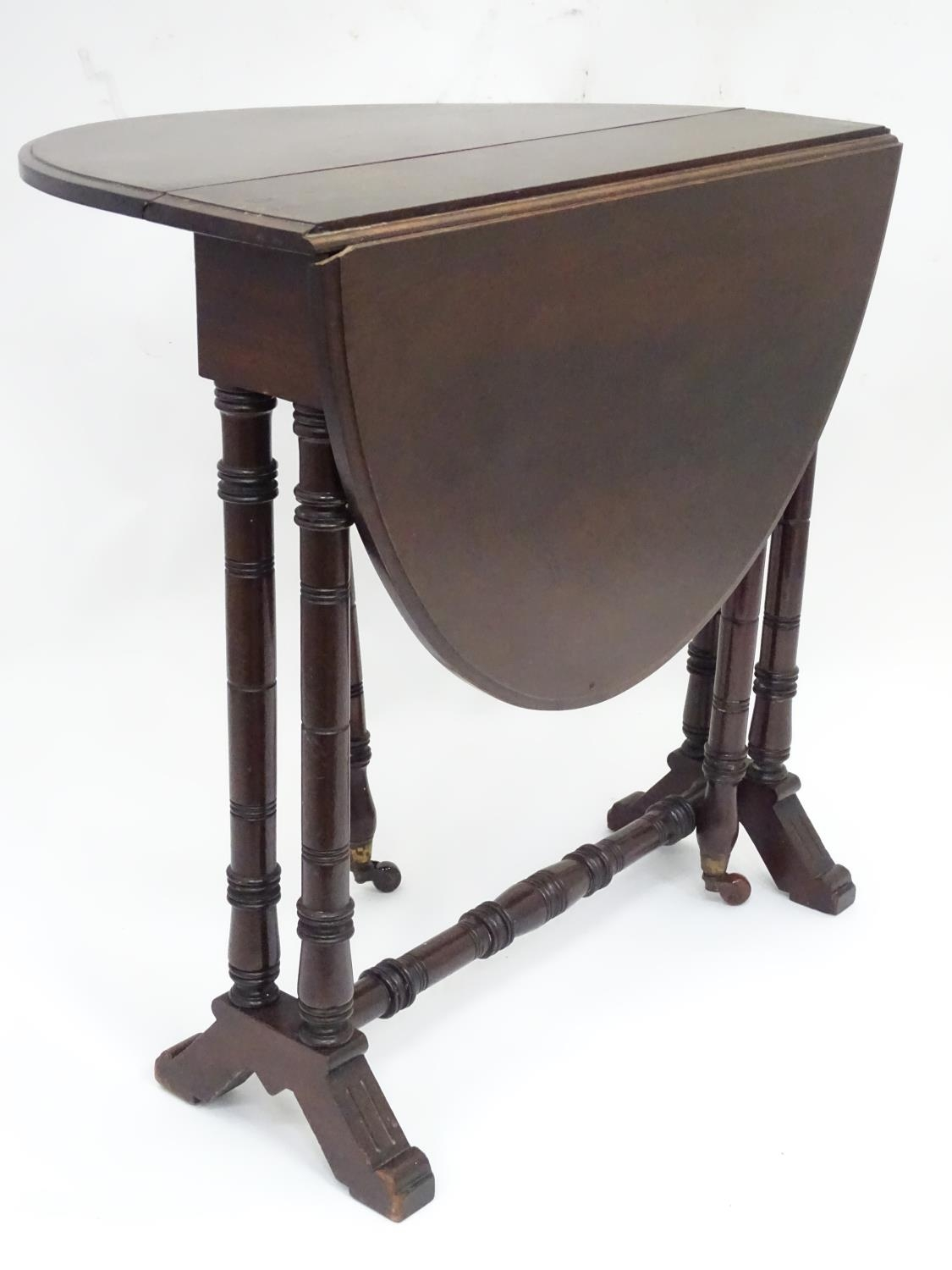"""A 19thC Sutherland table with an oval top. Approx. 29"""" wide Please Note - we do not make reference"""