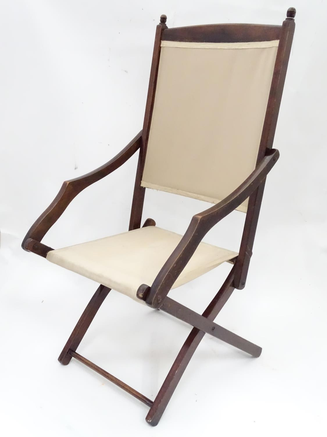 """A folding campaign / deck chair. Approx. 41"""" tall Please Note - we do not make reference to the"""