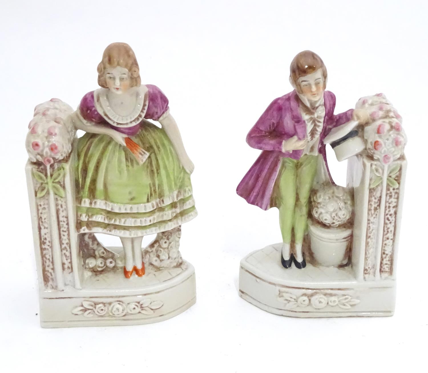 A pair of German porcelain figural bookends depicting a gentleman and a lady with flowers. Marked - Image 2 of 13