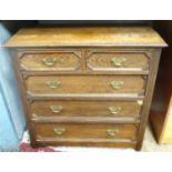 A two over three oak chest of drawers with geometric decoration Please Note - we do not make