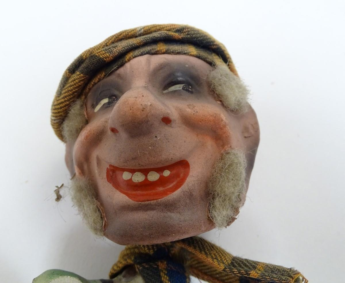 Toys: Two unusual novelty humorous Scottish figures made of pressed card. A wind up toy modelled - Image 2 of 9