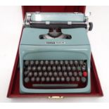 A 20thC Olivetti Studio 44 typewriter, the case with shipping labels Please Note - we do not make