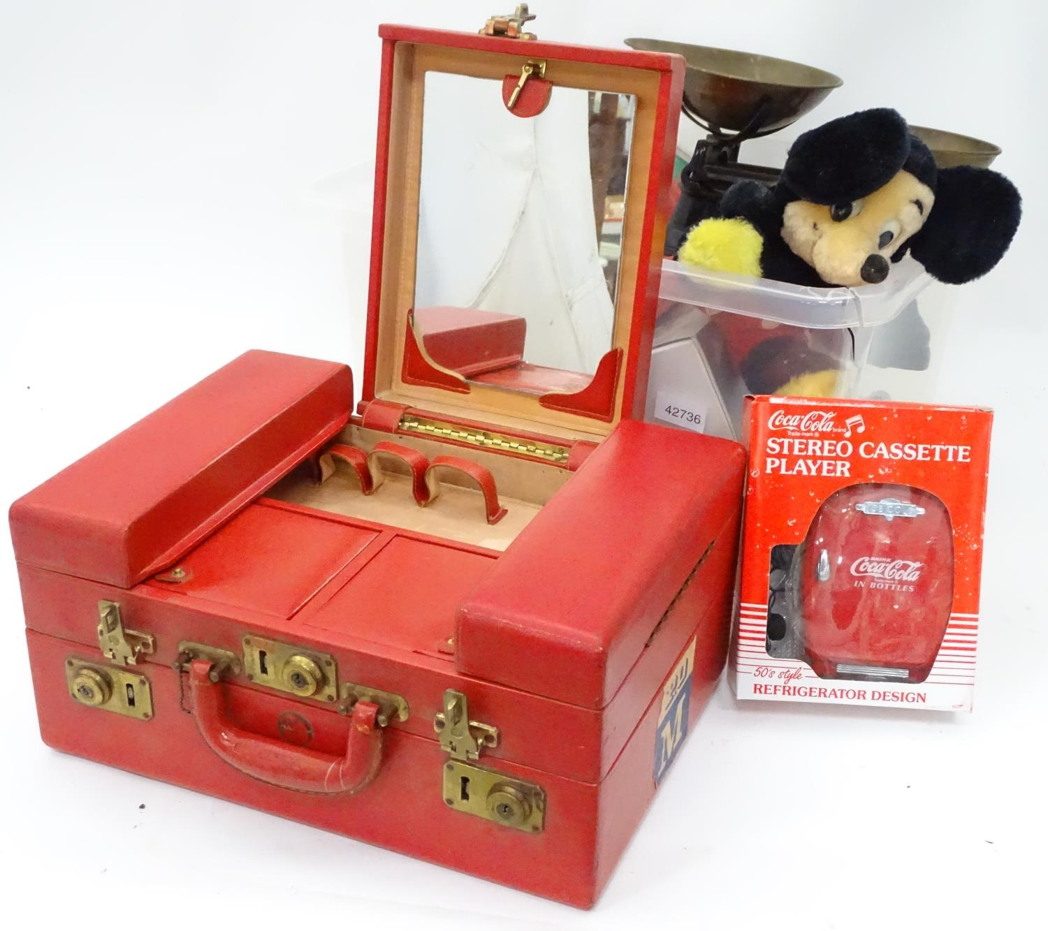 A box of miscellaneous items to include a large vanity case, scales, Mickey Mouse clock, etc. Please