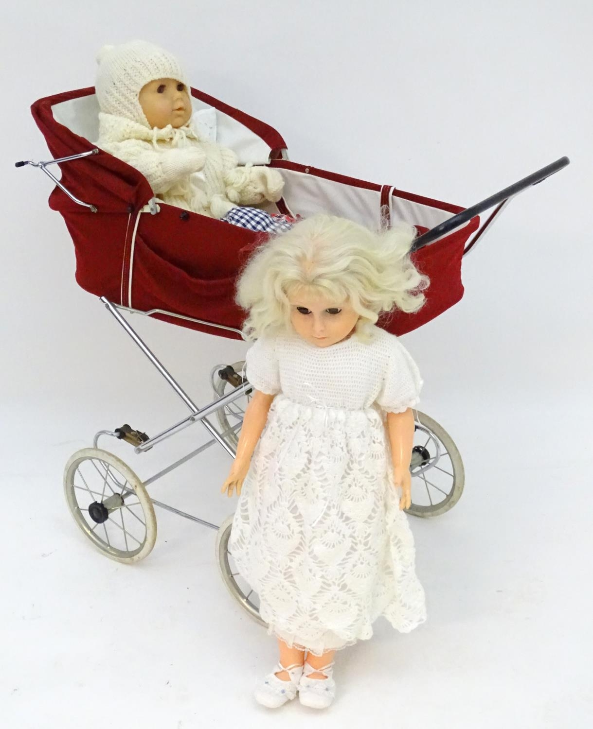 A 20thC dolls pram together with two dolls (3) Please Note - we do not make reference to the