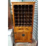 A kitchen cabinet with wine rack above two drawers and a cupboard Please Note - we do not make