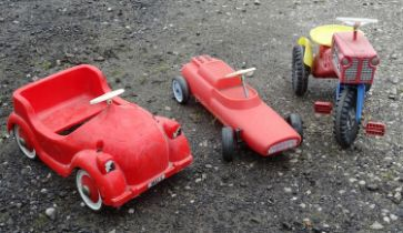 Three mid to late 20thC child's toy cars to include a Tri-ang racecar (3) Please Note - we do not