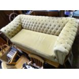 A two seater Chesterfield sofa Please Note - we do not make reference to the condition of lots