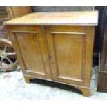 An early - mid 20th oak cupboard Please Note - we do not make reference to the condition of lots
