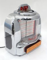A table top novelty juke box Please Note - we do not make reference to the condition of lots