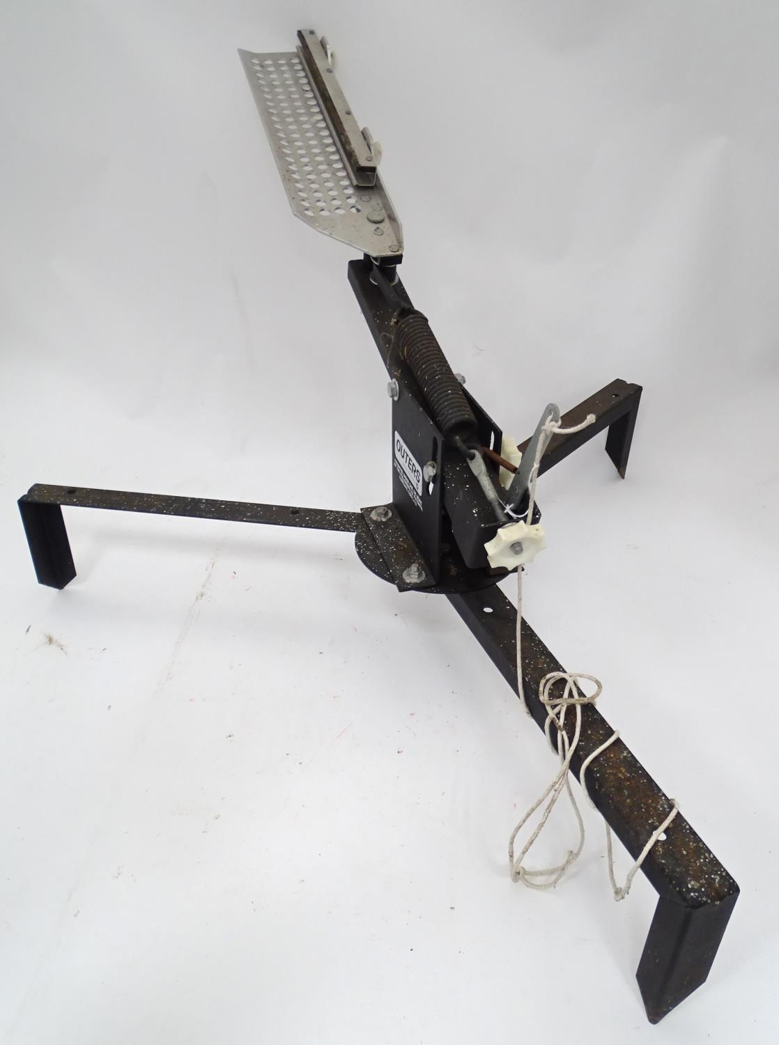 An American clay pigeon trap, maker Outers Please Note - we do not make reference to the condition