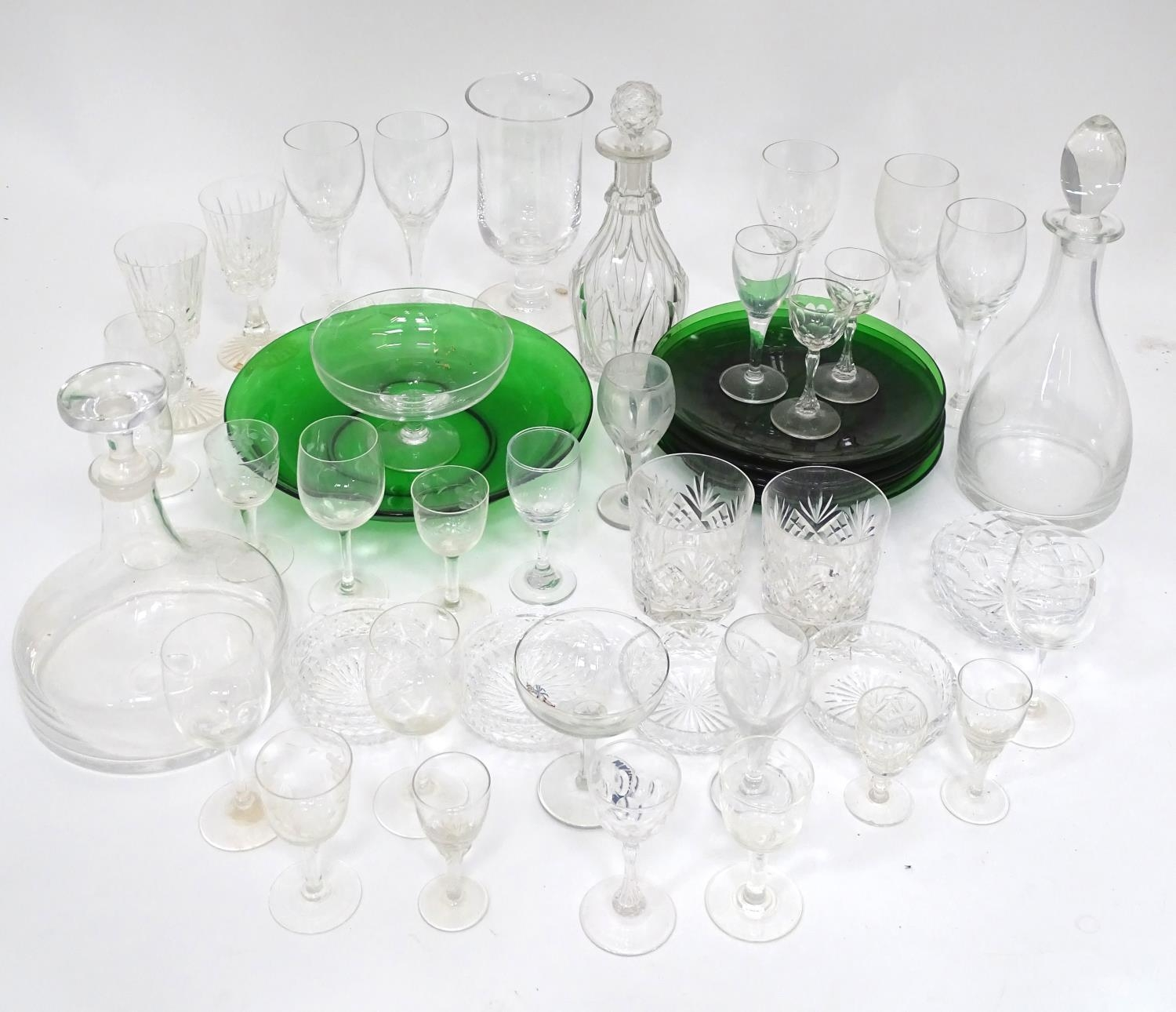 A quantity of assorted glassware to include decanters, drinking glasses, bowls etc Please Note -