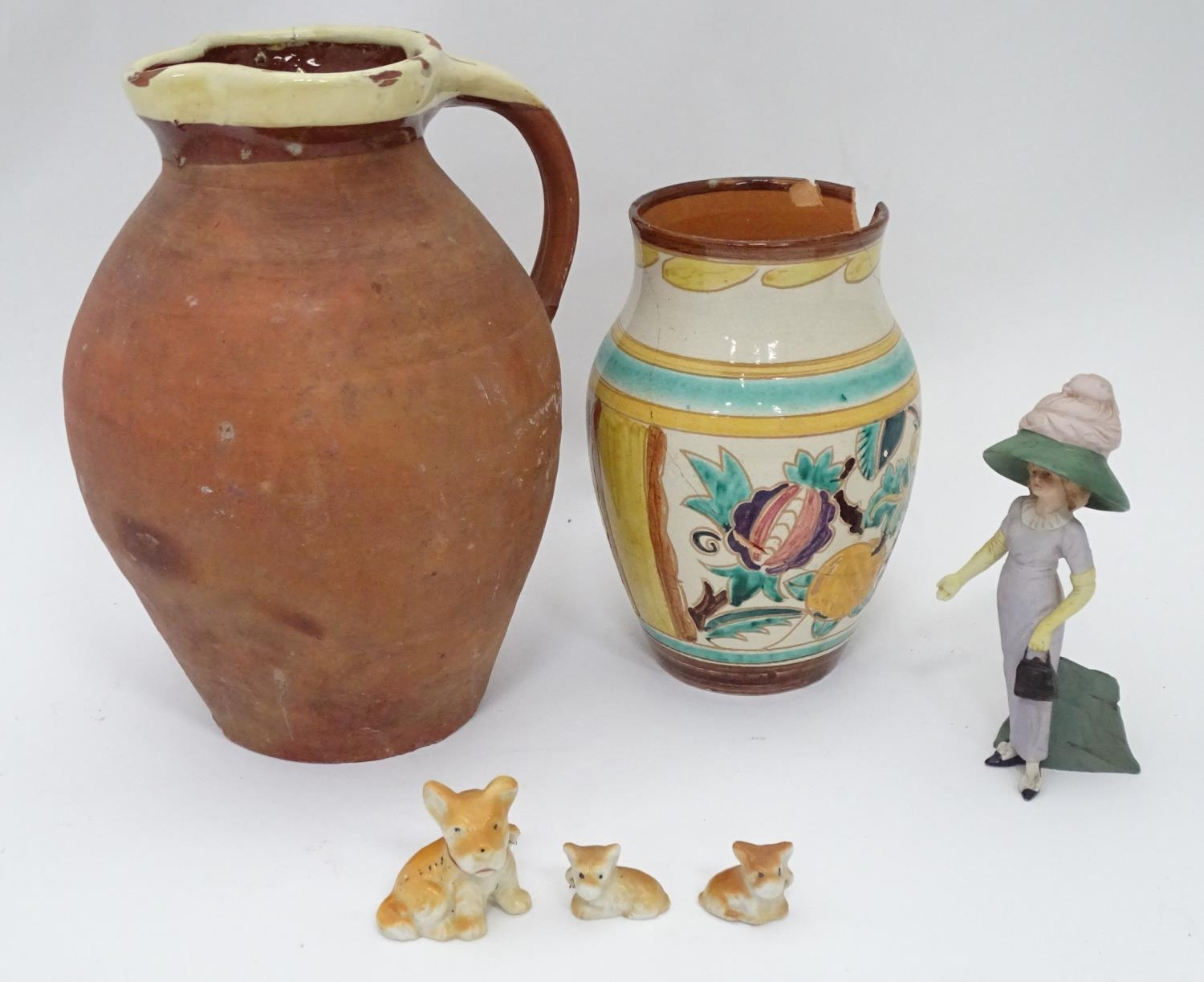 A 19thC terracotta jug together with a 20thC vase Please Note - we do not make reference to the