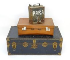 A canvas and leather trunk with brass reinforcements. Please Note - we do not make reference to