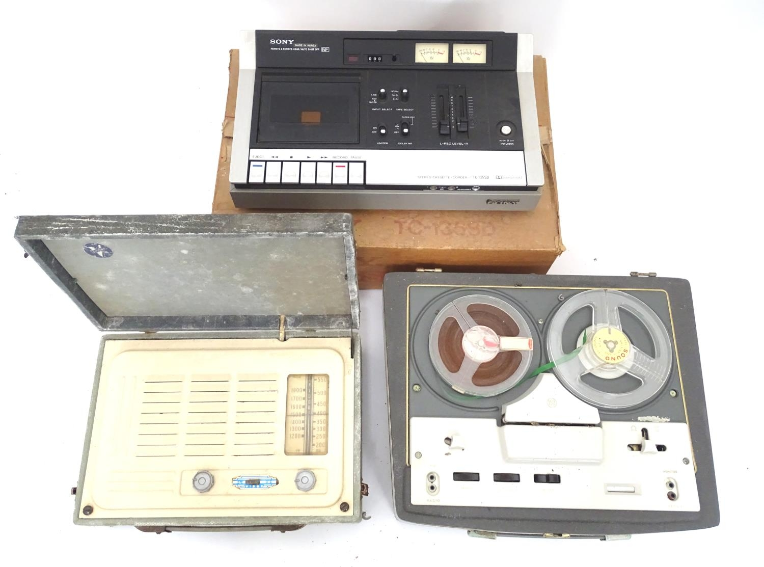 A boxed Sony cassette recorder together with a boxed Vidor radio and a reel to reel tape machine (3)