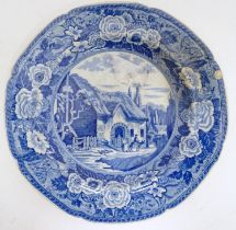 A 19thC blue and white plate decorated with a pastoral scene Please Note - we do not make