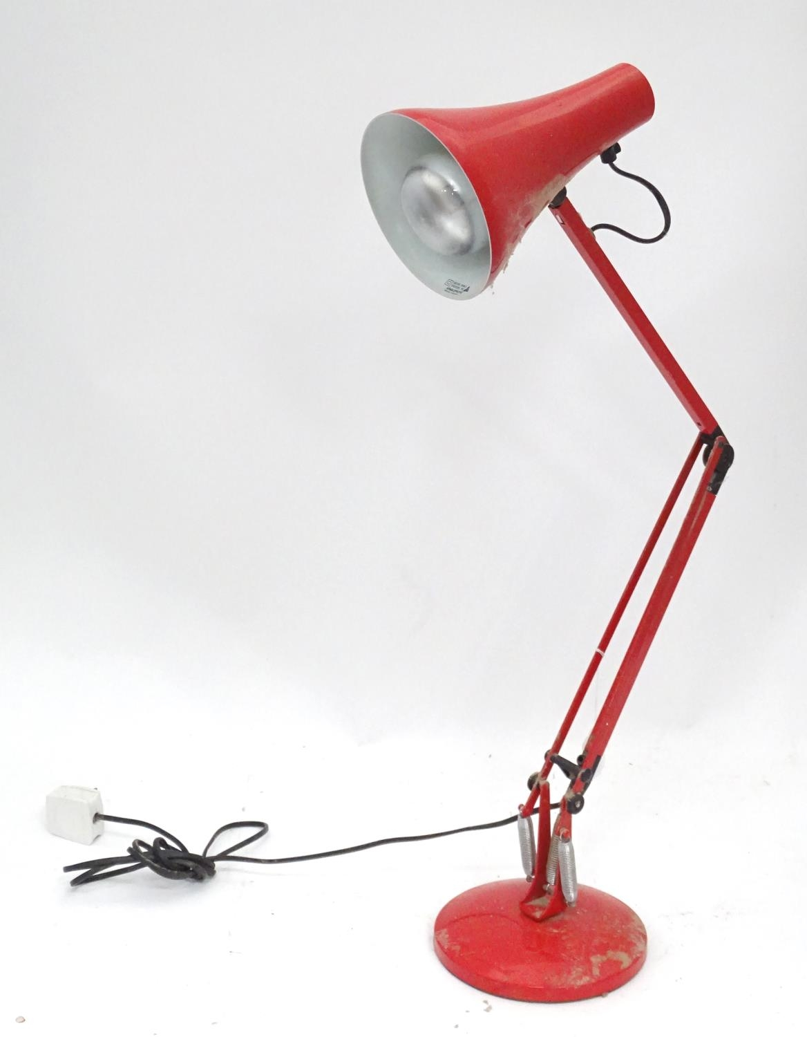 A red angle poise lamp Please Note - we do not make reference to the condition of lots within
