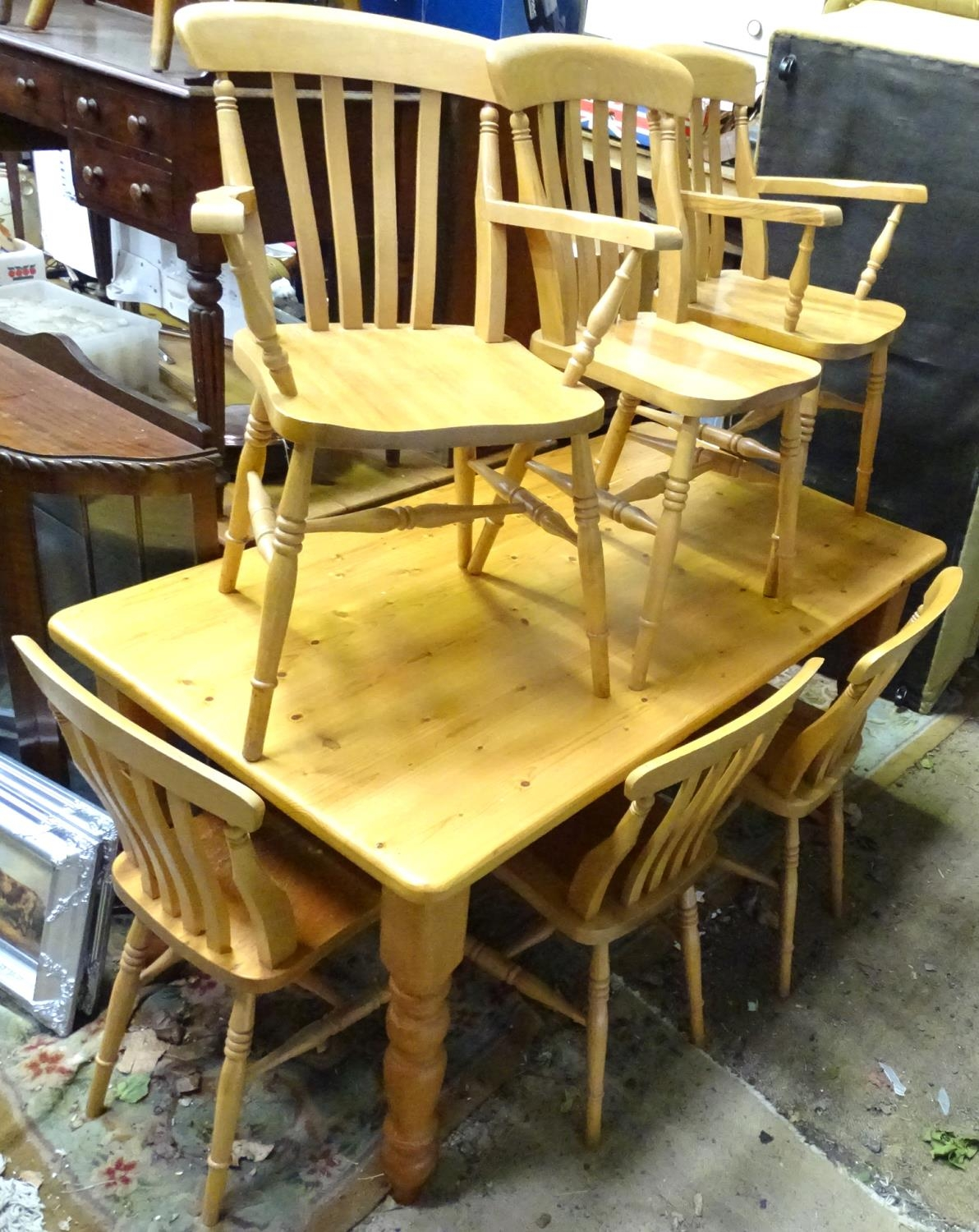 A pine dining table with 6 chairs Please Note - we do not make reference to the condition of lots