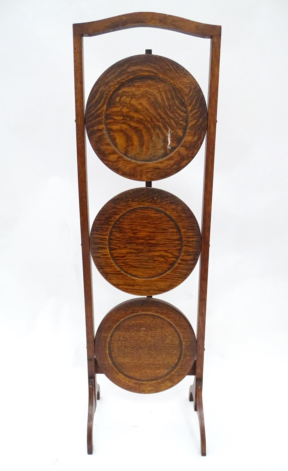 A 20thC three tier folding cake stand Please Note - we do not make reference to the condition of