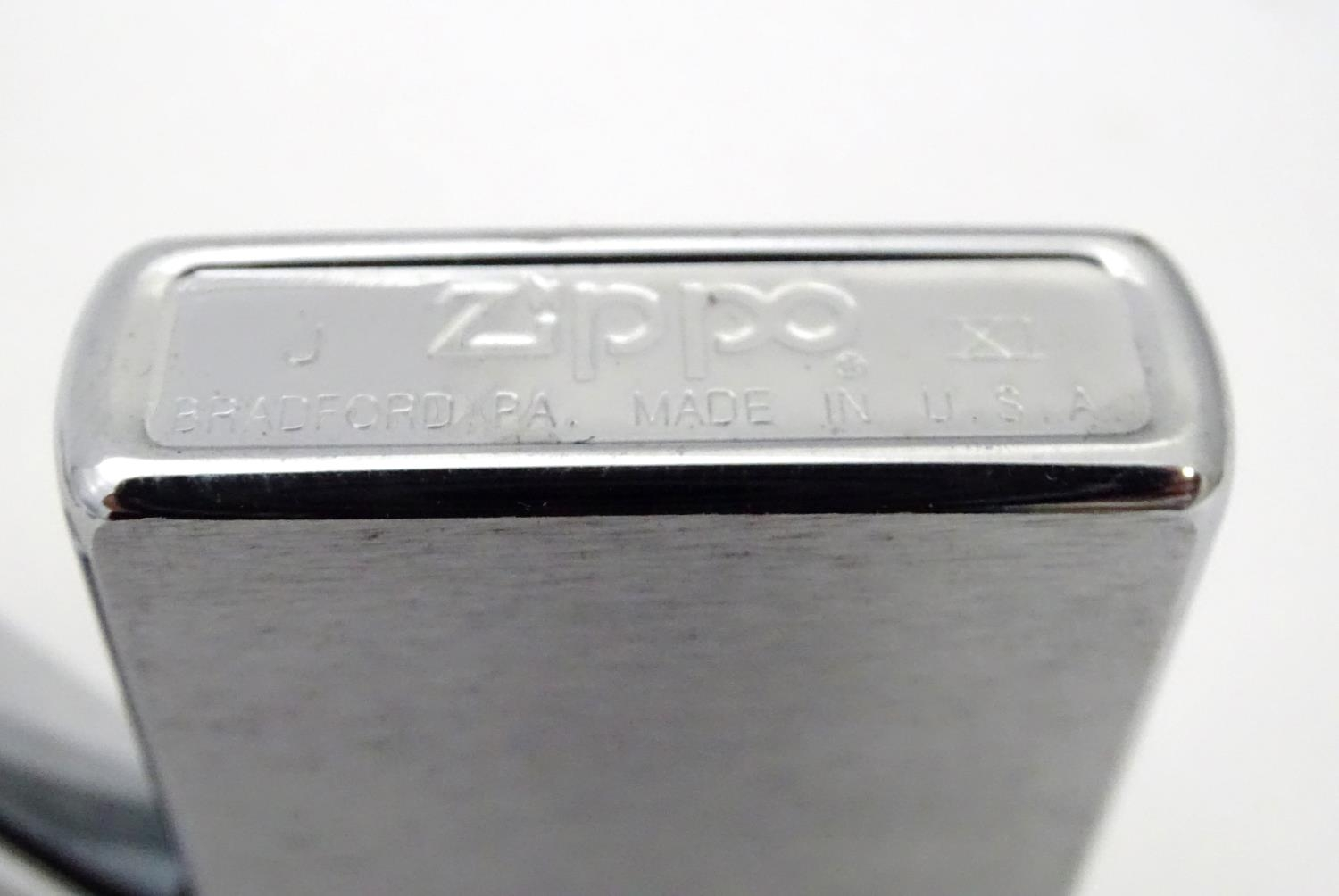 Fourteen Zippo lighters (14) Please Note - we do not make reference to the condition of lots - Image 2 of 7