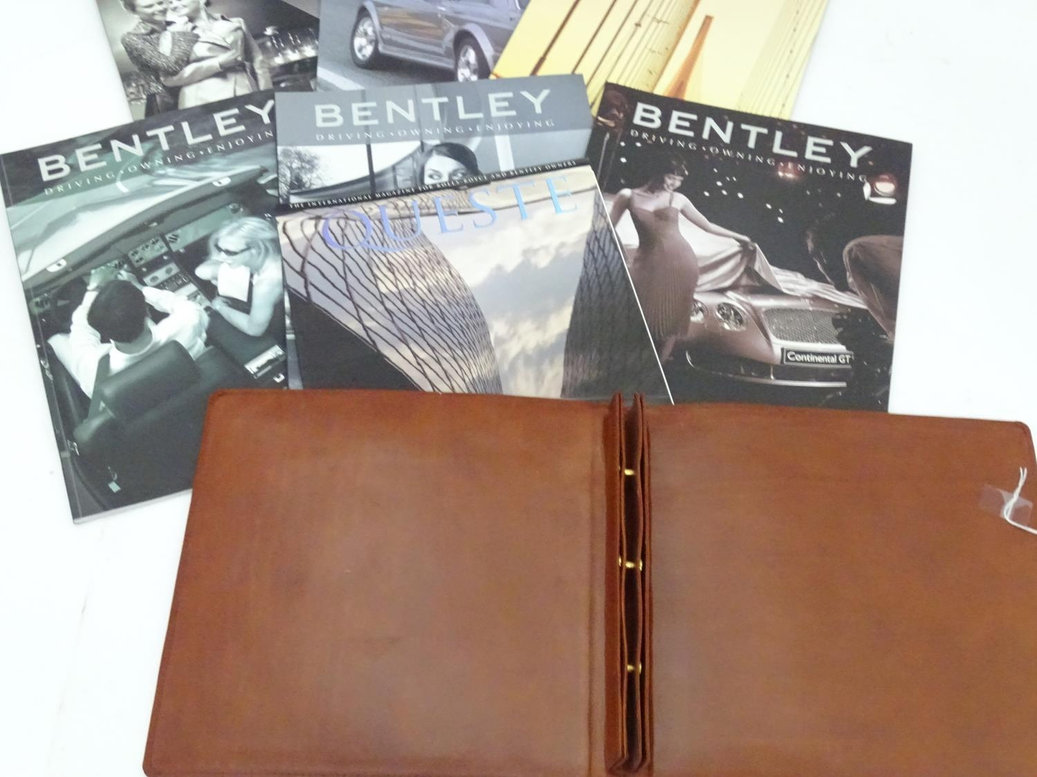A leather folder embossed with the Bentley car logo. Together with some Bentley magazines and a book - Image 4 of 6