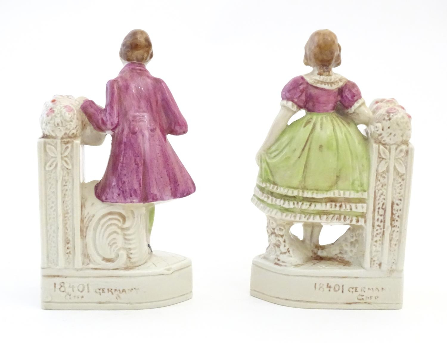 A pair of German porcelain figural bookends depicting a gentleman and a lady with flowers. Marked - Image 8 of 13