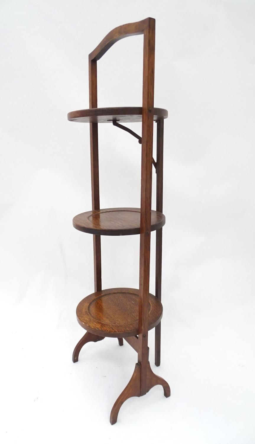 A 20thC three tier folding cake stand Please Note - we do not make reference to the condition of - Image 4 of 4