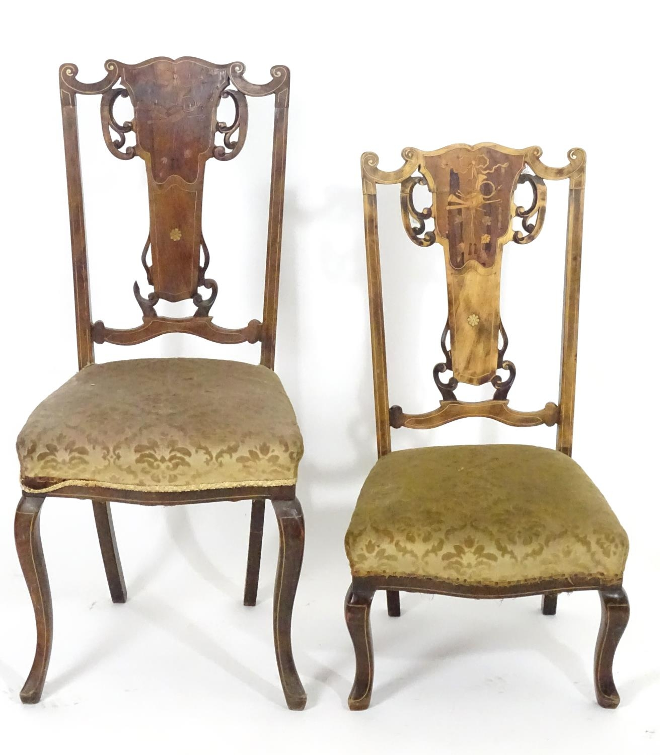 Two early 20thC side chairs with shaped top rails above tapered and pierced back splats with
