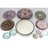 A quantity of assorted ceramics to include chargers, large wash bowl, Oriental bowls, vase, etc.
