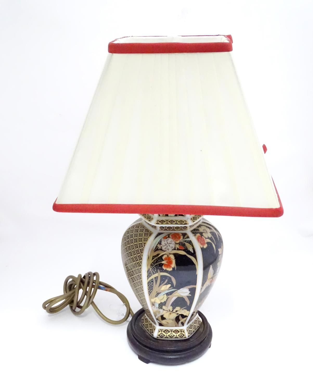 An Oriental style lamp with shade Please Note - we do not make reference to the condition of lots