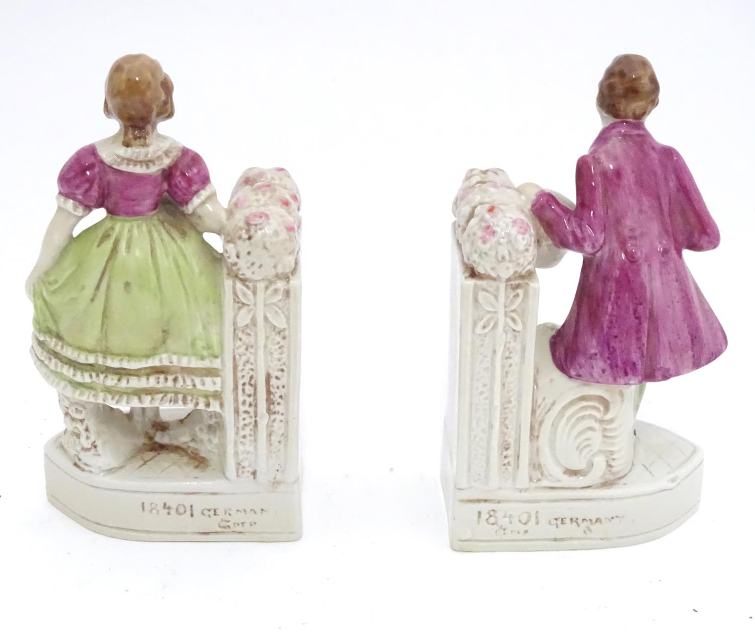 A pair of German porcelain figural bookends depicting a gentleman and a lady with flowers. Marked - Image 10 of 13