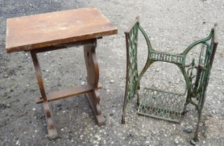 A small pub table. Together with a Singer sewing machine base. (2) Please Note - we do not make