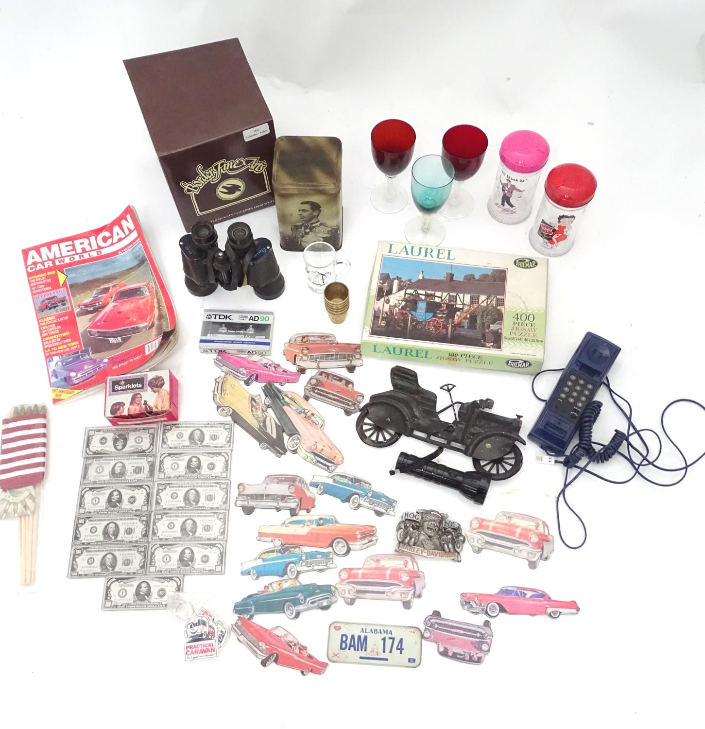A box of miscellaneous to include novelty phone, drinking glasses, wine glasses, binoculars etc.