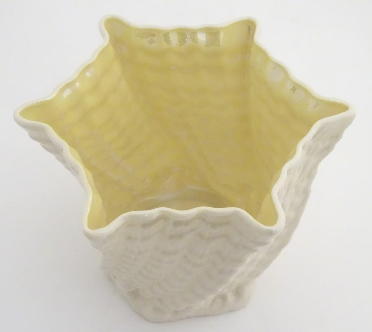 Two Belleek Ireland pottery wares, comprising a twisted lustre shell vase / flower pot with a - Image 7 of 9