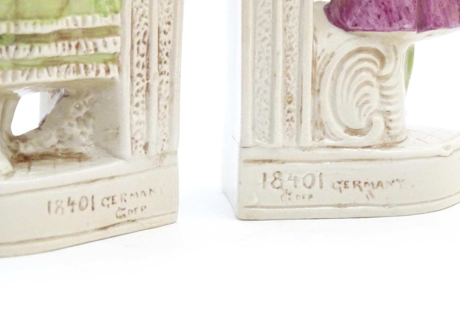 A pair of German porcelain figural bookends depicting a gentleman and a lady with flowers. Marked - Image 4 of 13