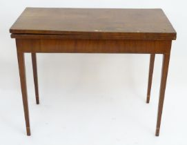 A Georgian mahogany fold over tea table Please Note - we do not make reference to the condition of