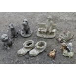 A quantity of garden ornaments to comprising 3 dogs, a tortoise, 2 boots, an old man and a bench and