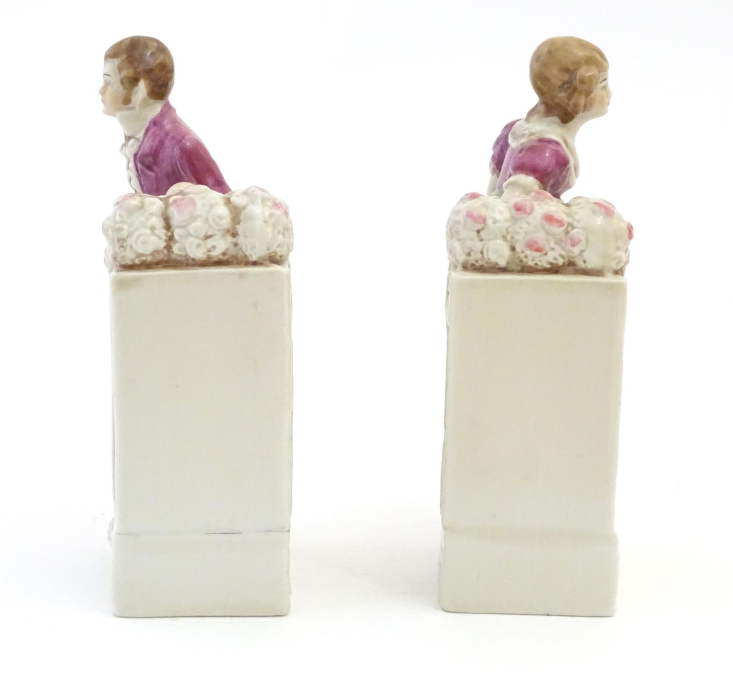 A pair of German porcelain figural bookends depicting a gentleman and a lady with flowers. Marked - Image 5 of 13