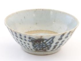 """An Oriental earthenware bowl with brushwork detail. Floral motif under. Approx. 2"""" x 5 1/2"""" Please"""
