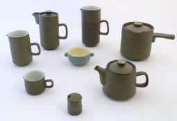 A quantity of Denby wares with impressed chevron detail, to include jugs, teapot, pans, mugs, etc.