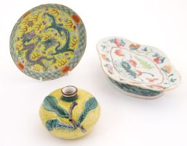 Three Oriental items, comprising a plate with a yellow ground decorated with dragons and a flaming