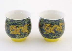 Two Chinese tea bowls of bulbous form with flared rims, with dragon and flaming pearl decoration.
