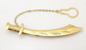 """A gold tie clip formed as a scimitar / sword marked 750. 2 1/4"""" long Please Note - we do not make"""