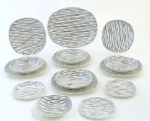 A quantity of retro Midwinter dinner wares in the pattern Zambesi, comprising plates, serving