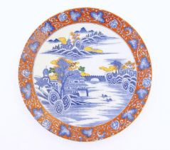 A Japanese charger depicting a mountain landscape scene with a river, boats, a bridge, pagoda
